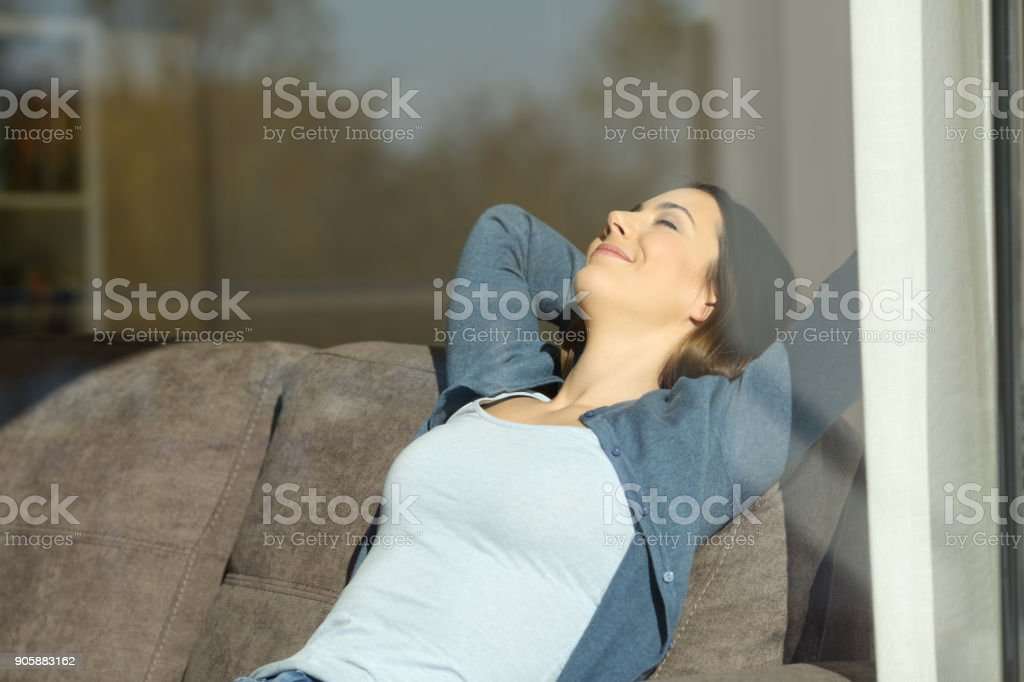 Girl resting at home on a couch stock photo