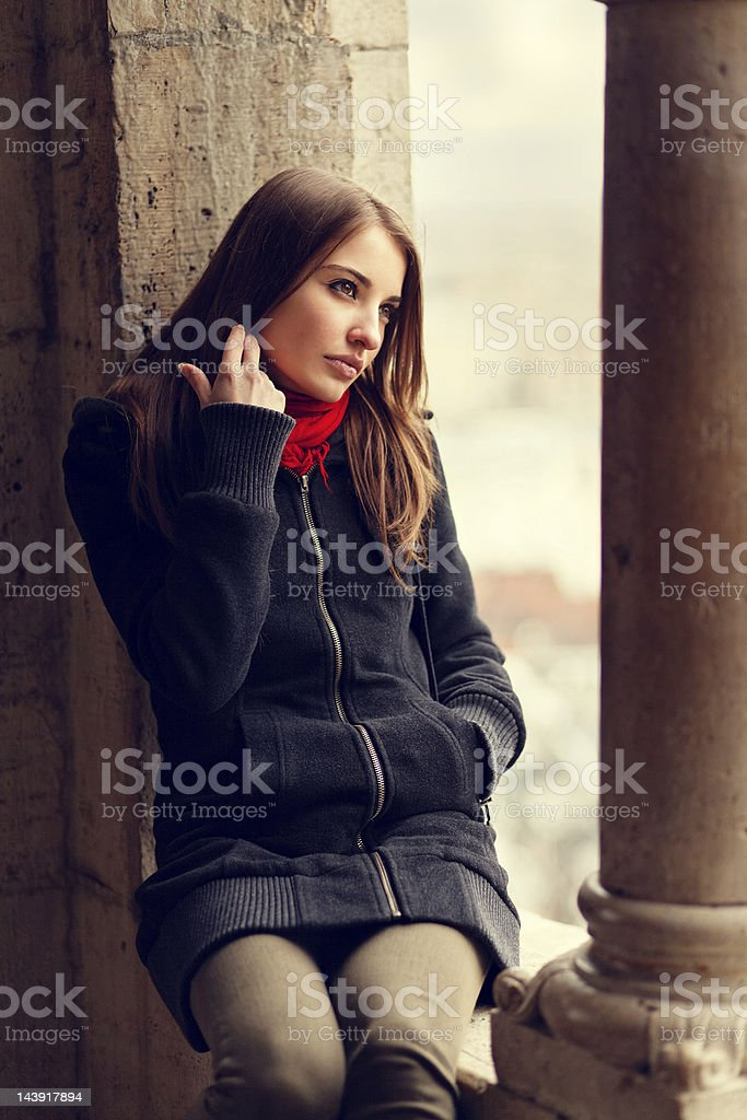 girl resting by the window royalty-free stock photo