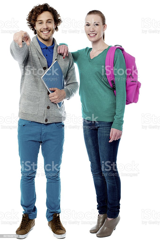 Girl resting her arm on classmates shoulder royalty-free stock photo