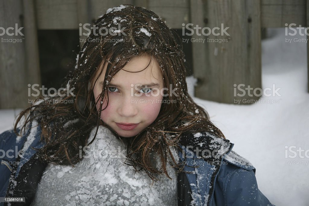 Girl Resting in Snowbank royalty-free stock photo