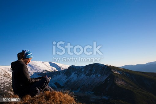 istock Girl resting in the mountains. 504016832