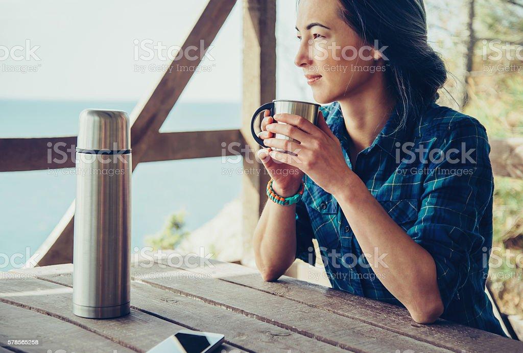 Girl resting in wooden veranda stock photo