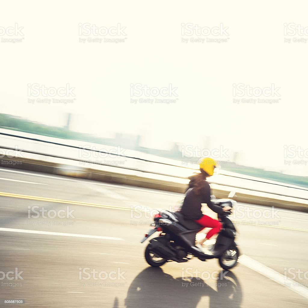 Girl ridding a motorcycle stock photo