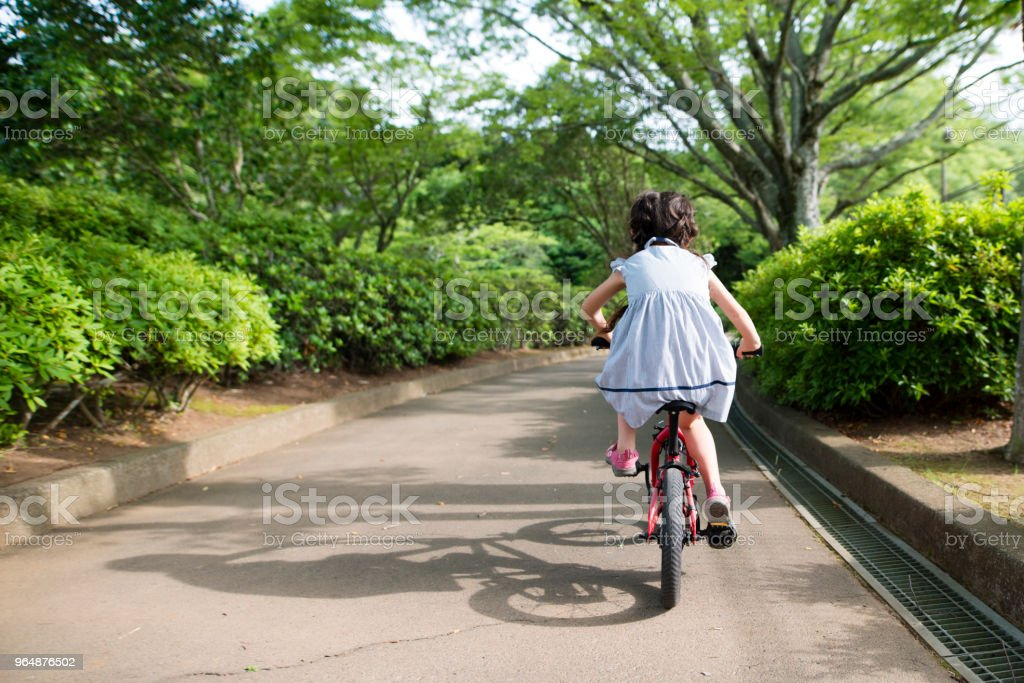 Girl riding a bicycle royalty-free stock photo