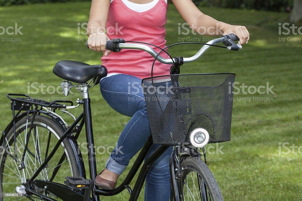 Girl riding a bike royalty-free stock photo
