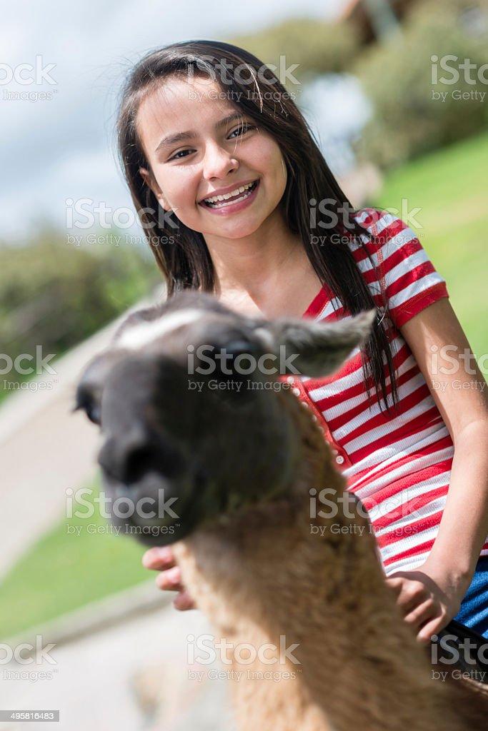 Girl riding a llama royalty-free stock photo