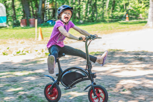 Girl Riding An Electric Bike 2 – zdjęcie