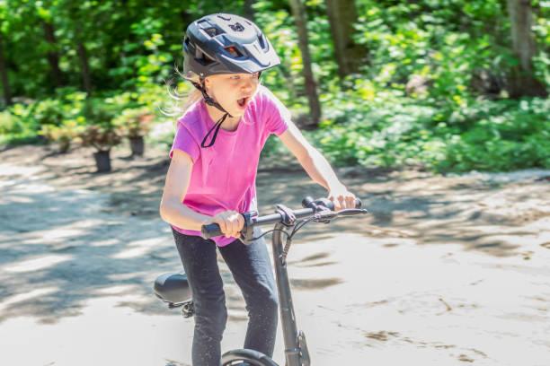 Girl Riding An Electric Bike 3 – zdjęcie