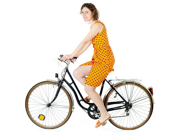 girl riding bicycle stock photo