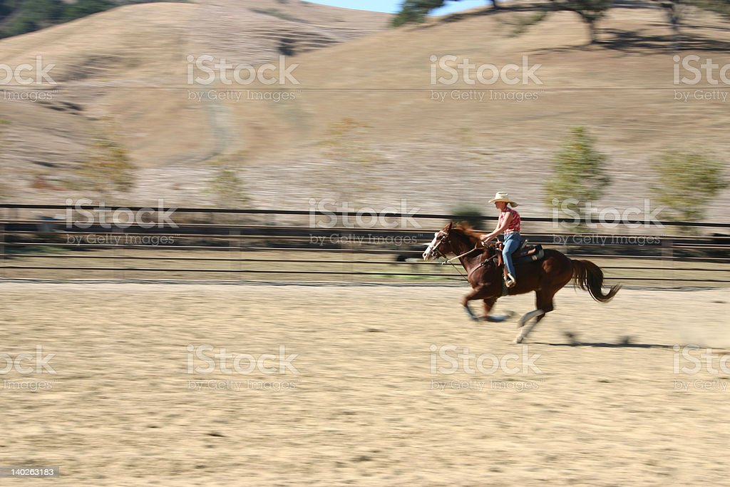 Girl riding horse going fast stock photo