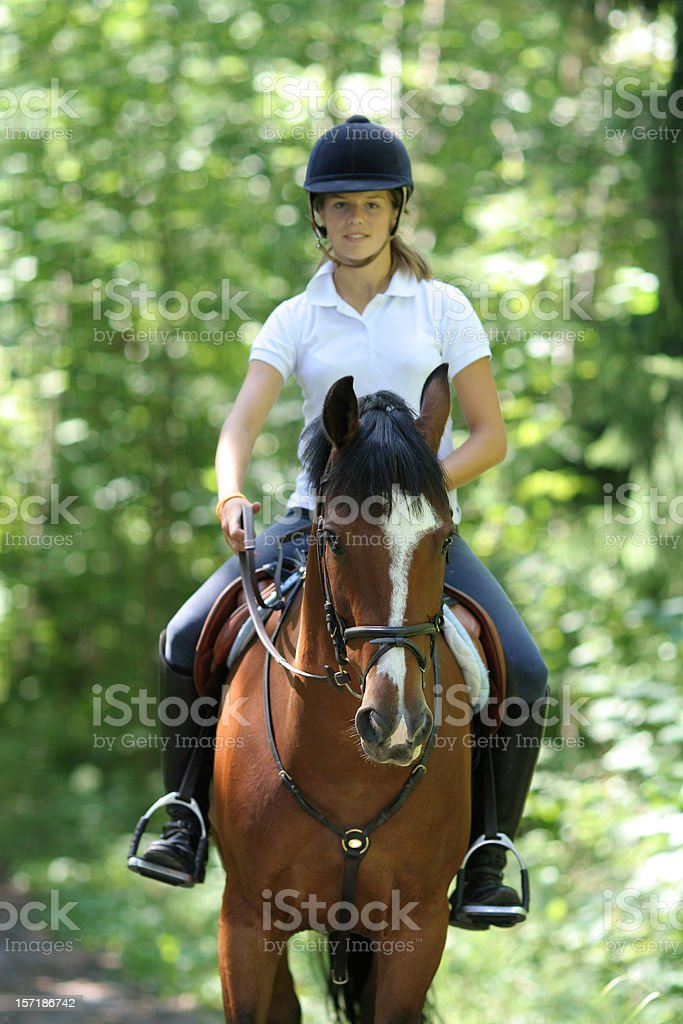 Girl riding in the forest, Norway stock photo