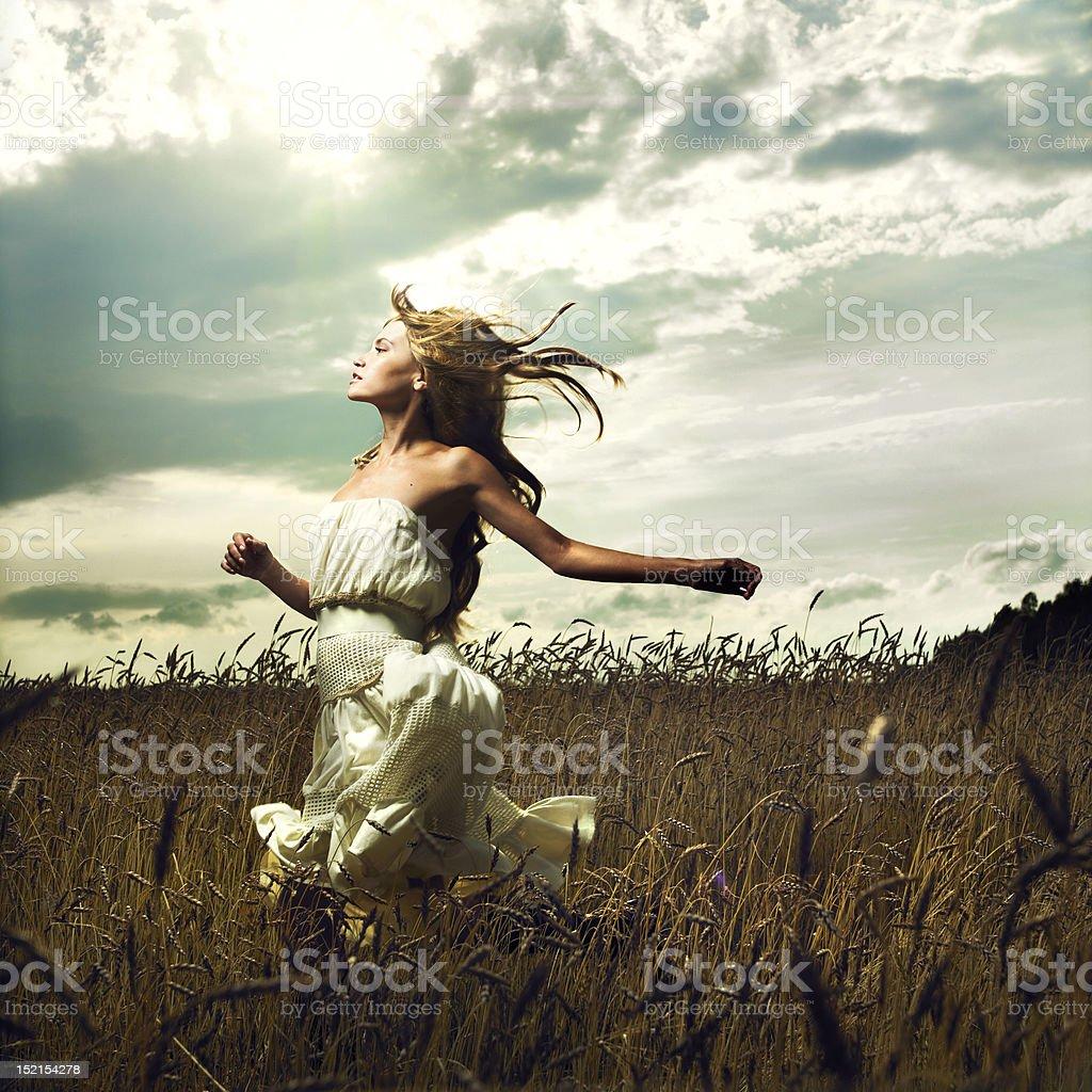 Girl running across field royalty-free stock photo