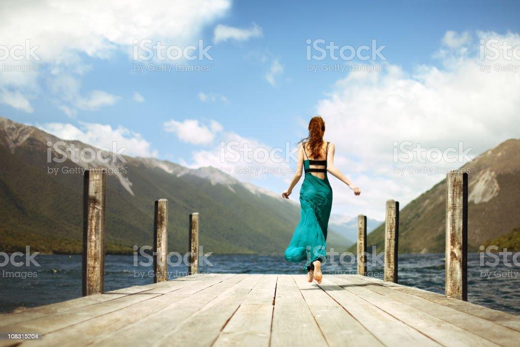 Girl running away stock photo