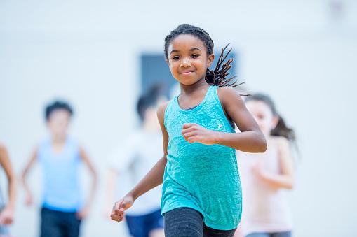 Girl running in gym