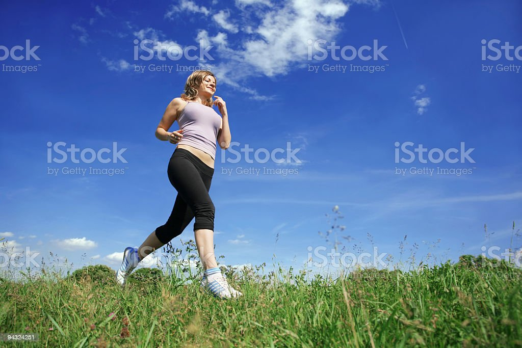 Girl running on meadow royalty-free stock photo