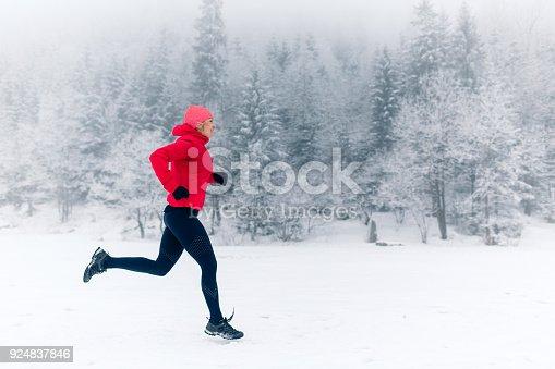 484750230 istock photo Girl running on snow in winter mountains 924837846