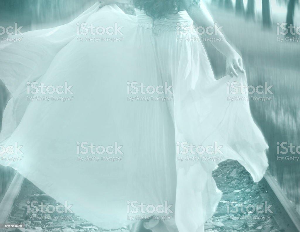 Girl Running on Tracks royalty-free stock photo