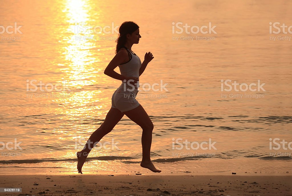 Girl running outdoor. royalty-free stock photo