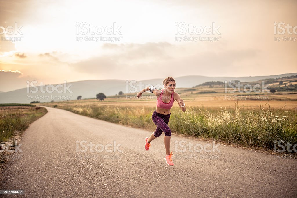 Girl running stock photo