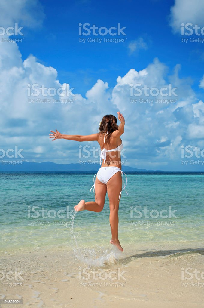 Girl running to sea. royalty-free stock photo