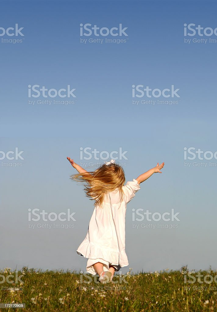 Girl running with Open Arms - Clear Blue Sky royalty-free stock photo