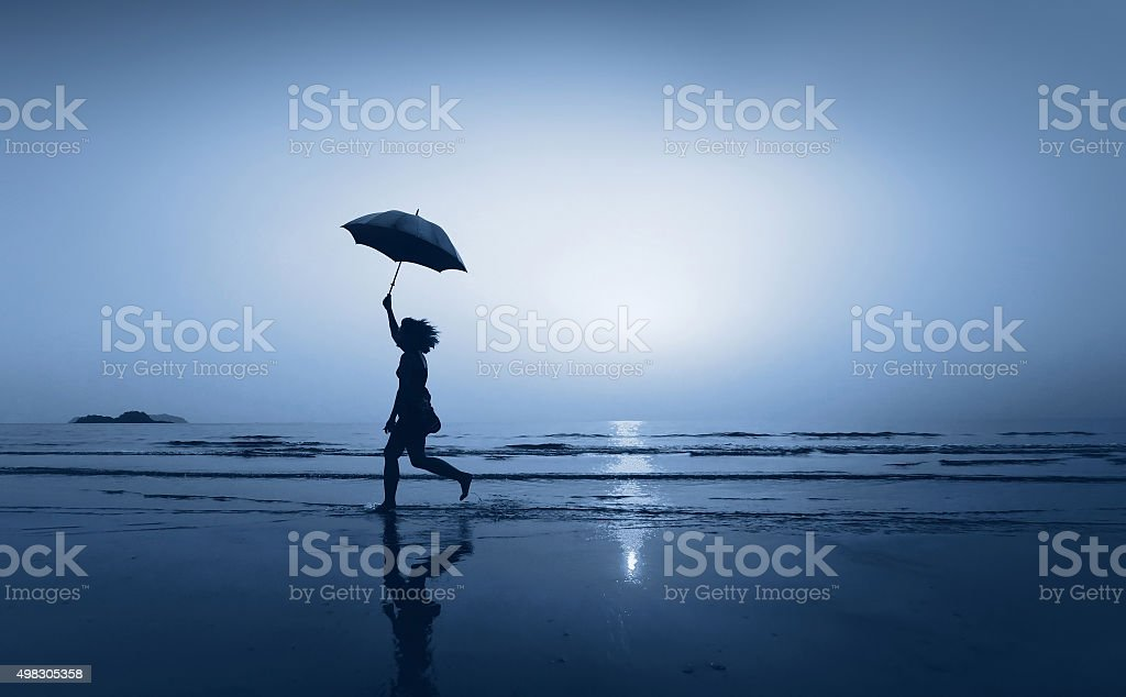 girl running with umbrella, concept stock photo