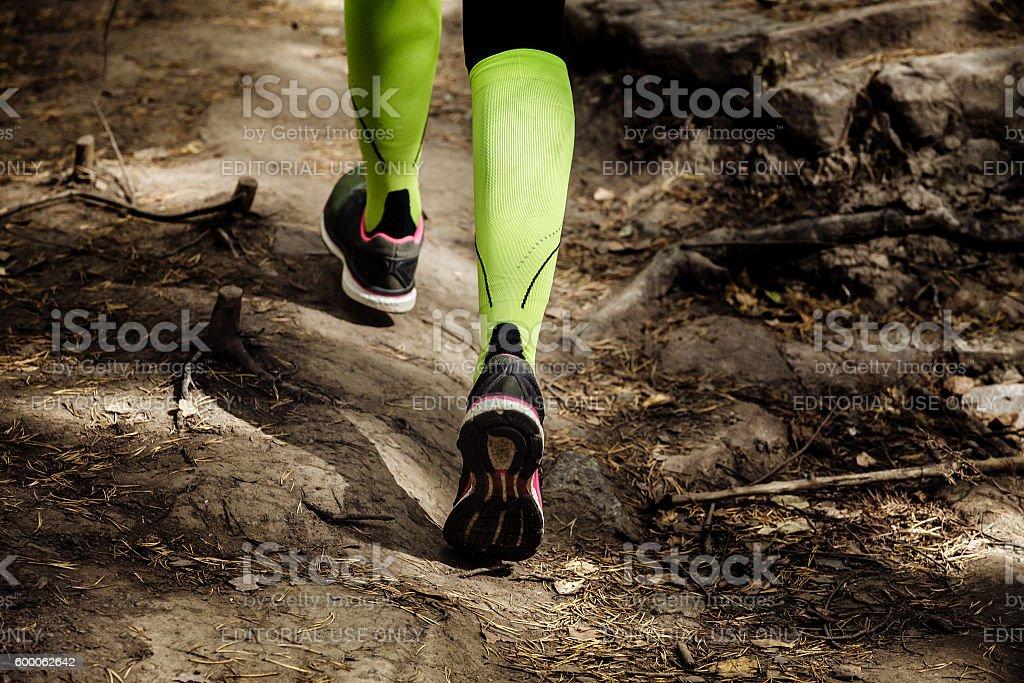 girl runs a marathon stone trail stock photo