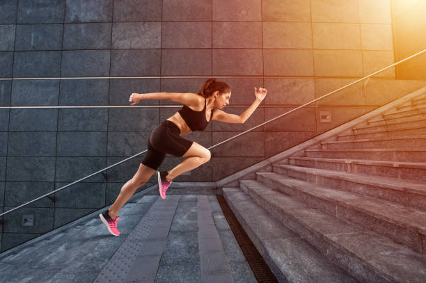 Girl runs fast on a modern stair - foto stock