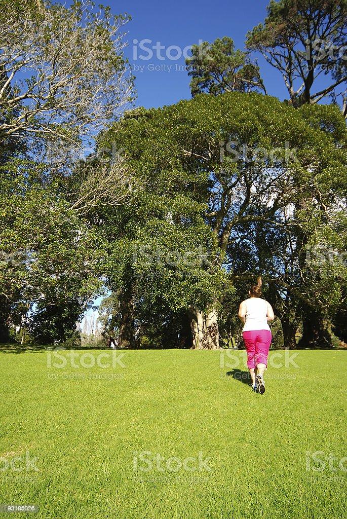 Girl runs up hill royalty-free stock photo