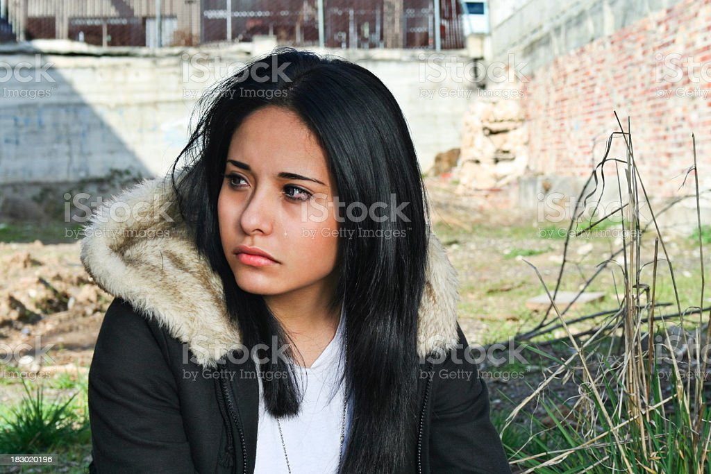 Girl sad and hopeless in an empty lot  stock photo
