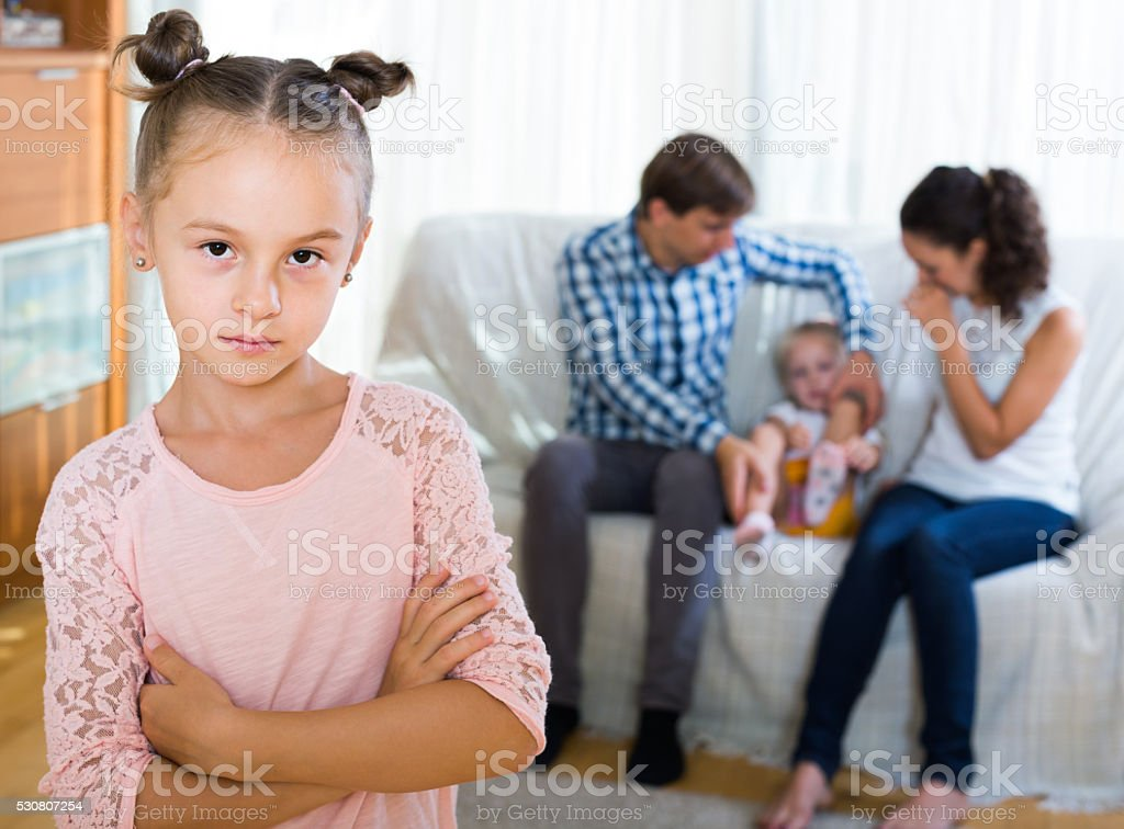 Girl Sad Because Of Jealous Younger Sister To Parents Stock