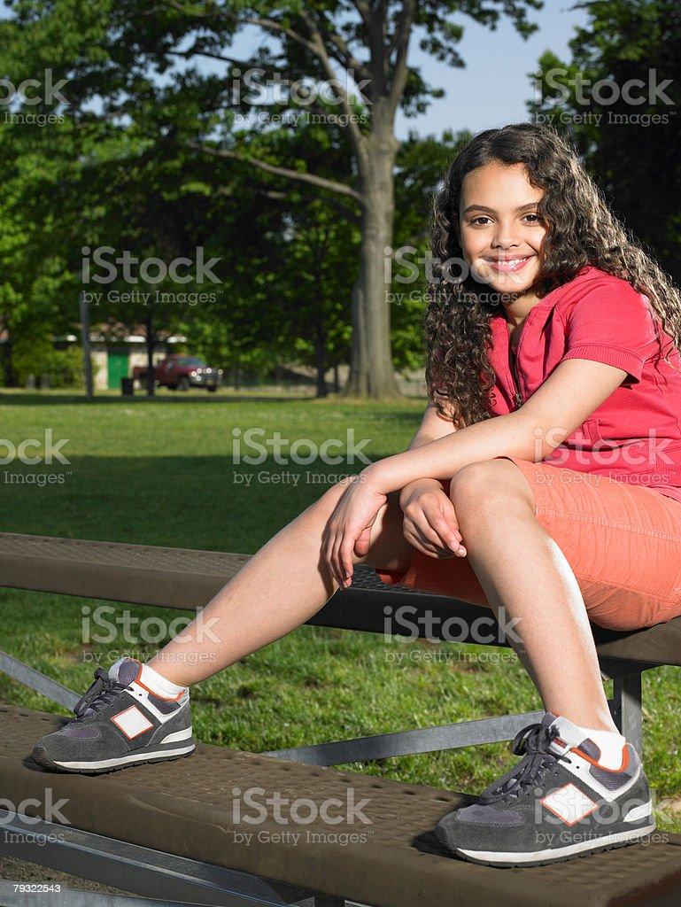 A girl sat on a bench 免版稅 stock photo