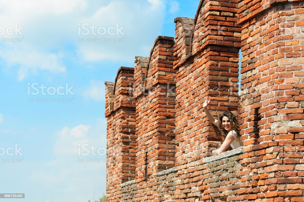 Girl saying goodby from the caslte stock photo