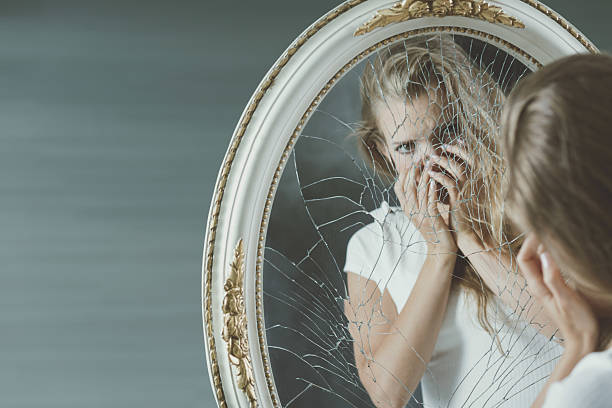 Girl scared of herself Pretty teenage girl with mental problem scared of her mirror reflection low self esteem stock pictures, royalty-free photos & images