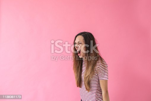 1138361116 istock photo A girl screams or expresses emotions 1138361173