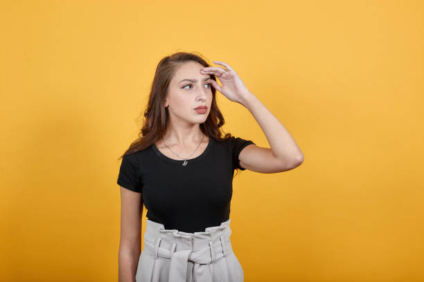 Girl searching for something and thinking also being thoughtful and dazzled. Beautiful girl looks perplexed and looking here and there. She is thinking as well searching for something around. dazzled stock pictures, royalty-free photos & images