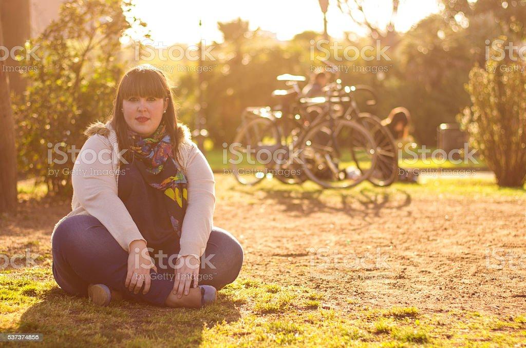 girl seated barcelona stock photo