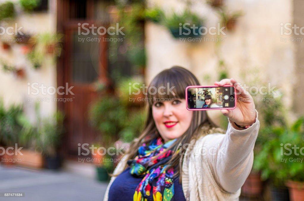 girl selfie horizontal barrio barri born barcelona apple iphone stock photo