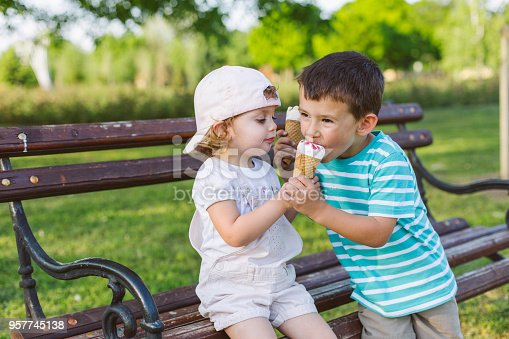958492394 istock photo girl share her ice cream with brother 957745138
