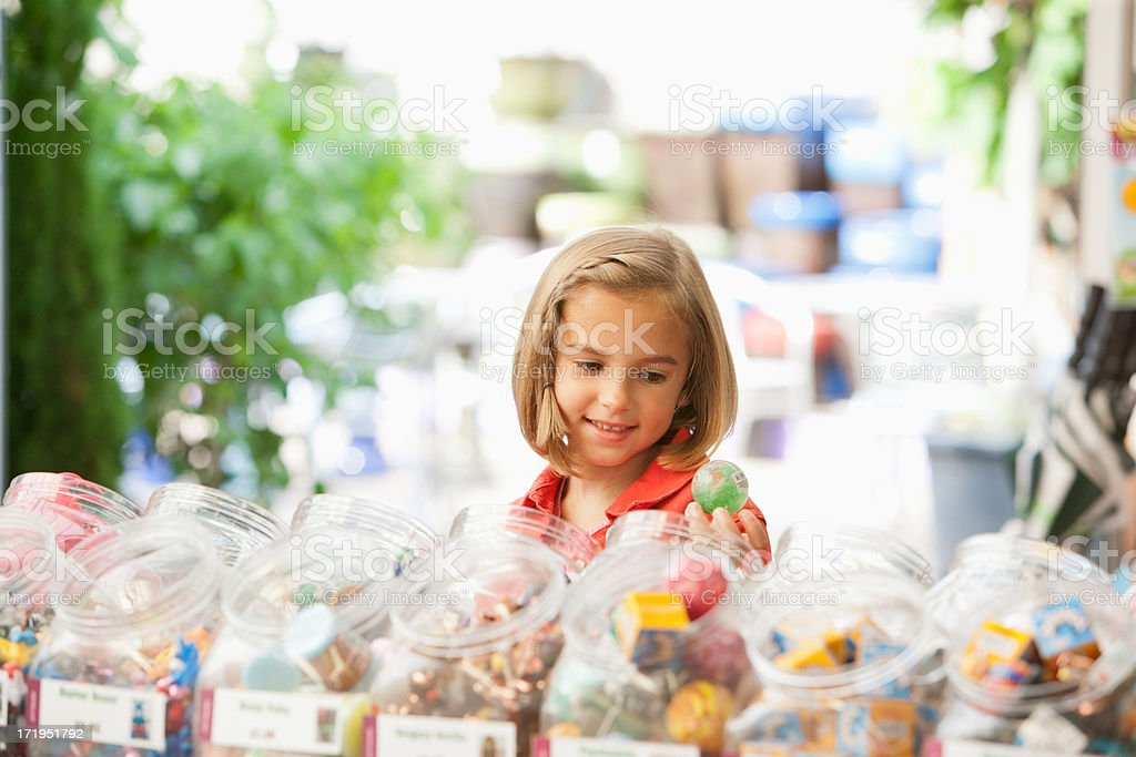 Girl shopping in toy store royalty-free stock photo
