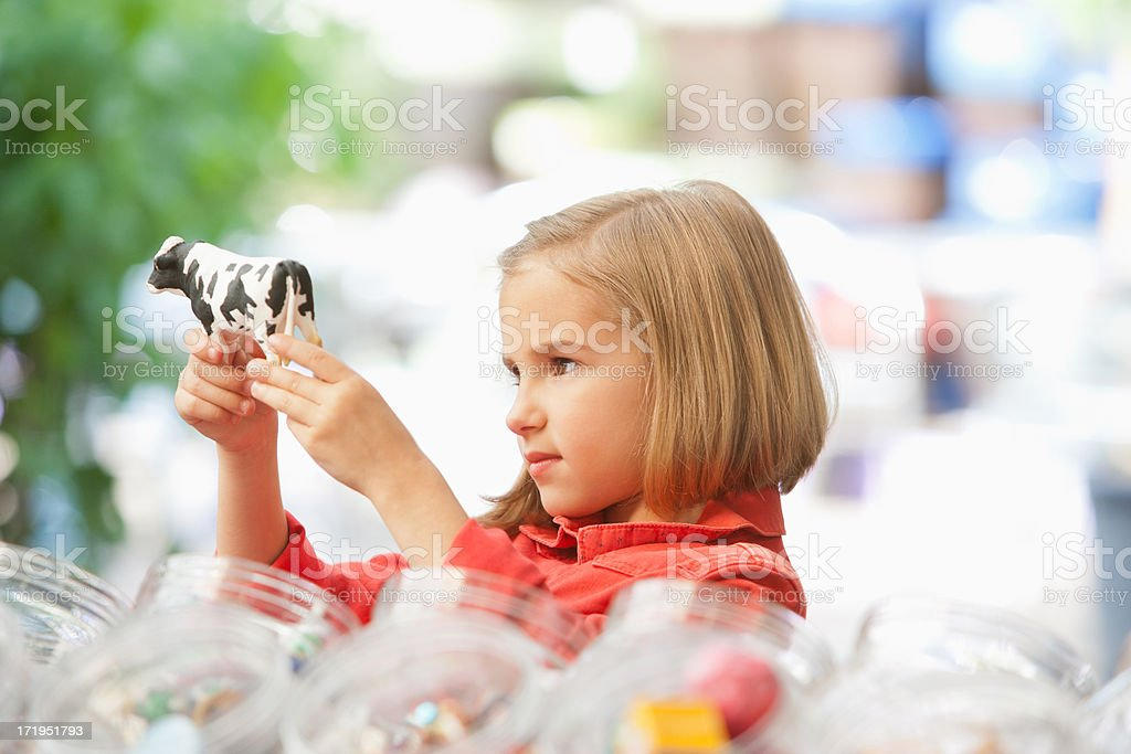 Girl shopping in toy store stock photo