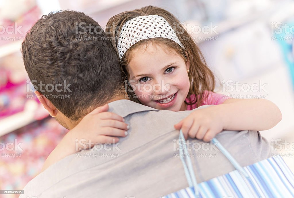 Girl shopping with her father stock photo