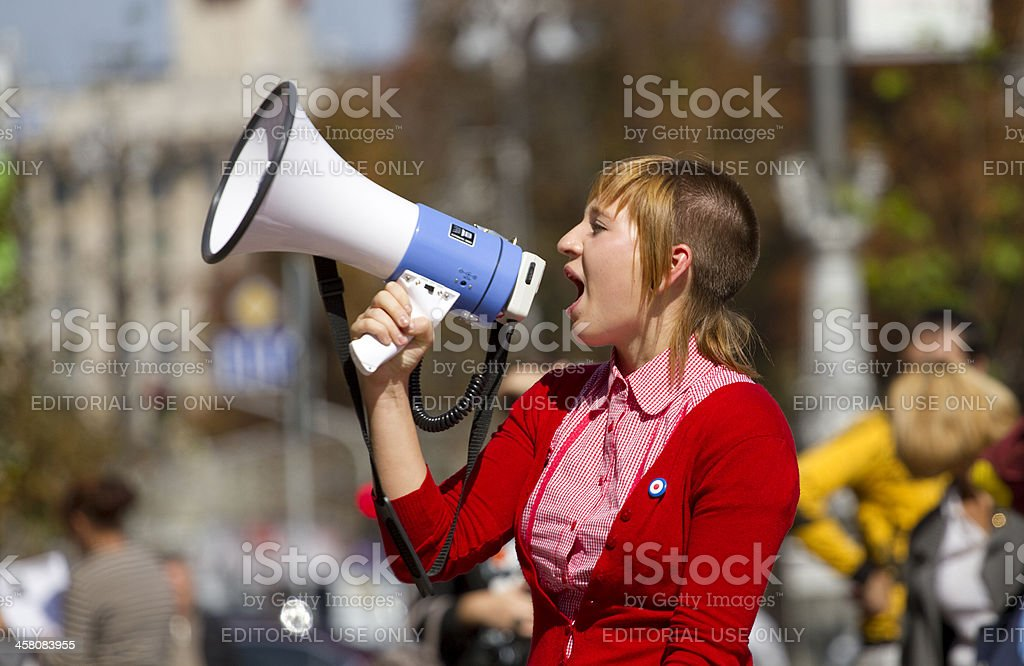 Girl shouts in a megaphone . royalty-free stock photo