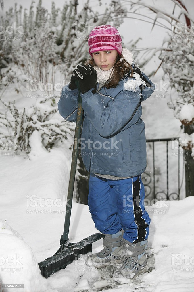 Girl Shovels Snow on Walk and Stairs royalty-free stock photo