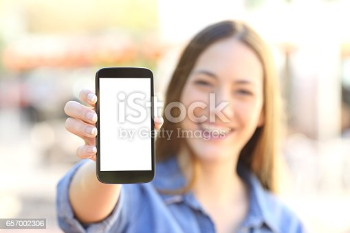 istock Girl showing a blank smart phone display 657002306