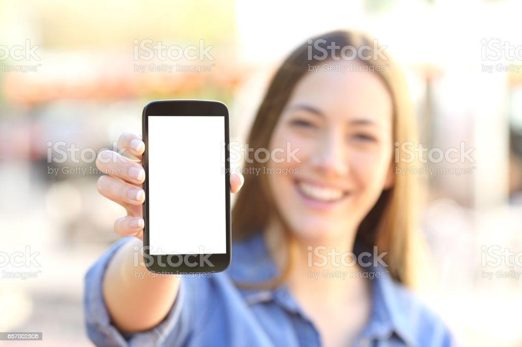 Girl showing a blank smart phone display stock photo
