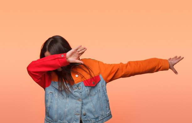 Girl showing dab dance stock photo