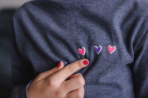 Girl showing hearts on her chest