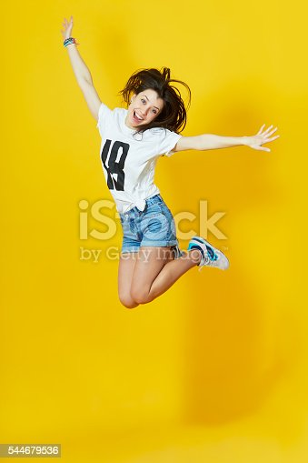 istock Girl showing her tongue and peace gesture 544679536