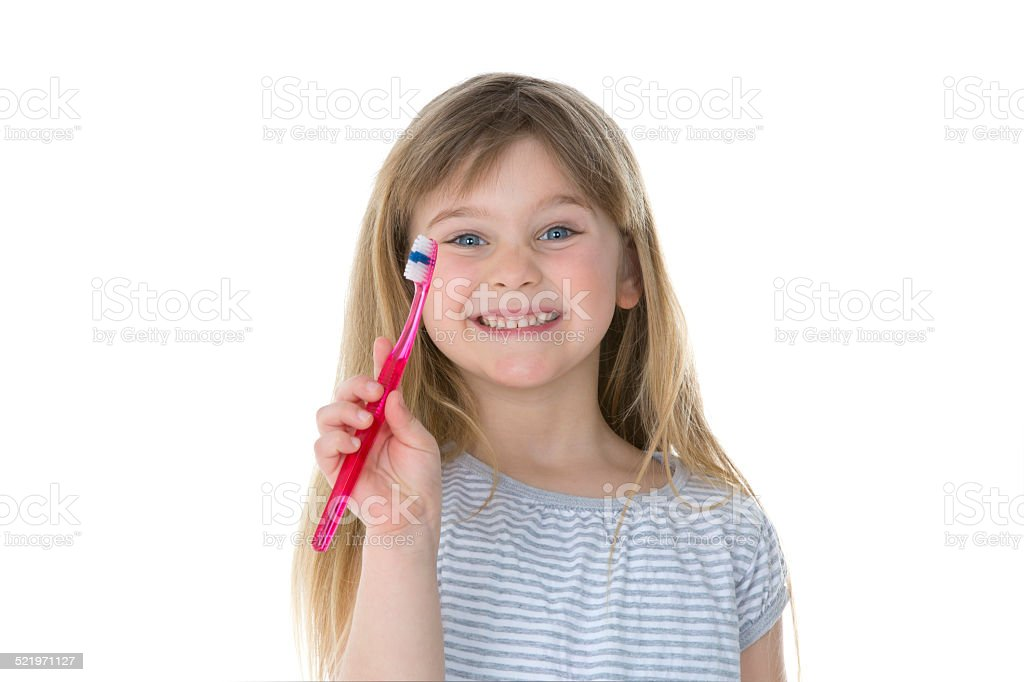 girl showing her toothbrush stock photo